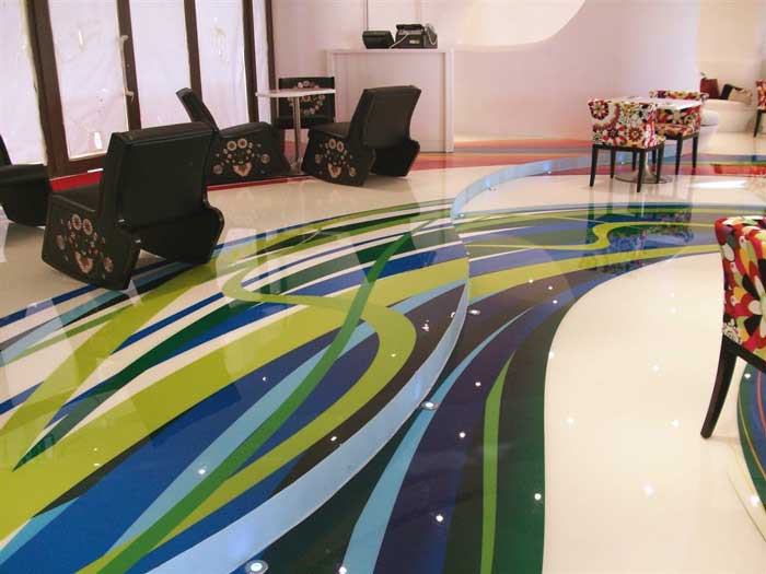 The colorful patterns on the floors of the BoHouse Café are vinyl decals augmented in some areas with Elite Crete's Reflector Enhancer.