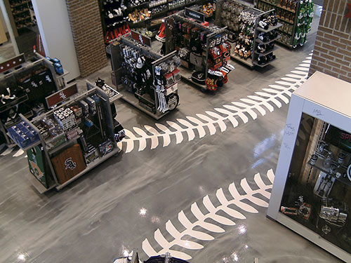 Enhancing the store's interior design further are its epoxy-coated concrete floors, which were installed in White Sox team colors by a crew from decorative concrete floor design and installation company