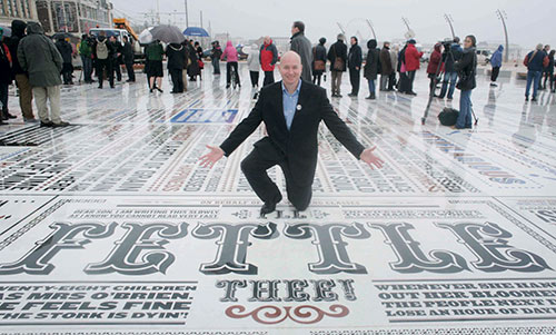 Graphic designer Andy Altmann of Why Not Associates, London, presents the Comedy Carpet he helped create.