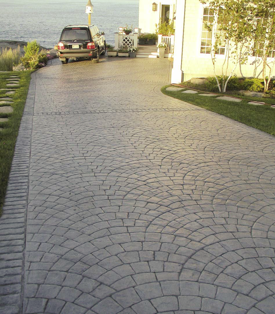 Concrete driveway stamped with radial stamp pattern