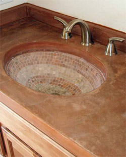 Decorative Concrete Sink with mosaic in the basin.