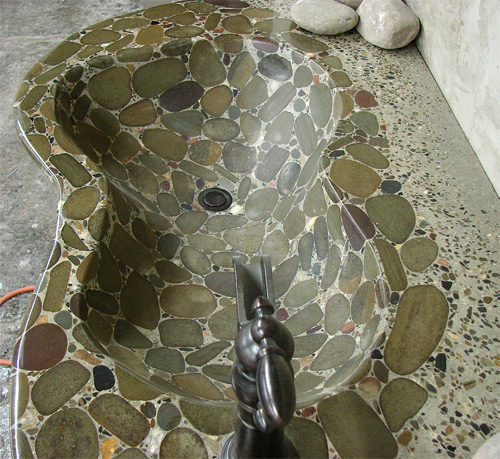 A sink crafted by Mark Celebuski. The cement-rich mix had no problems bonding to inlaid stones.