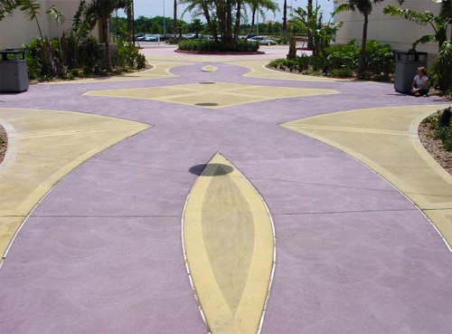 A walkway for Sheplers Western Wear at Festival Bay Mall at International Drive, in Orlando, Fla., features integral colors Purple Dawn and Bamboo, produced at the time by QC Construction Products.