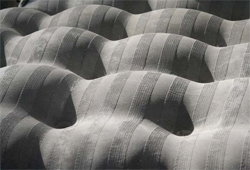 Fabric forms can be used to produce complex concrete shapes that would be extremely costly or nearly impossible to create with traditional rigid formwork. Anne-Mette Manelius, an architect and doctoral student in Copenhagen, Denmark, made this chair as part of her thesis work on fabric formwork for concrete. She wanted the soft-looking chair to fool sitters.