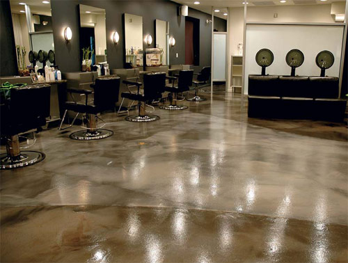 An epoxy floor in a salon in grays and browns.