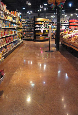 Custom Concrete Solutions LLC transformed this retail space with stained concrete that is reflective enough to see the lights of the ceiling.