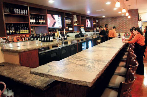 gold surface and built a jagged-edged cream and gray bar top for the Memphis-style barbecue eatery in July 2009.
