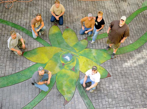 Bob and Lee Ann Harris led volunteers and workshop participants in completing the Aloe Vera Courtyard at the Children's Museum of Phoenix. Materials came from Brickform, Smith Paints and Borders Construction Specialties. Hanson Aggregates of Arizona donated concrete.