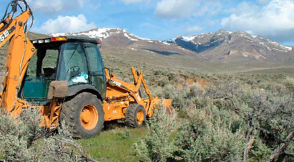 Lander County, Nevada: Desert terrain and neutral, almost bland, colors provide contrast to and act as a great canvas for punchy colors, such as the orange of this backhoe, or, better perhaps, the rich blue of the sky.