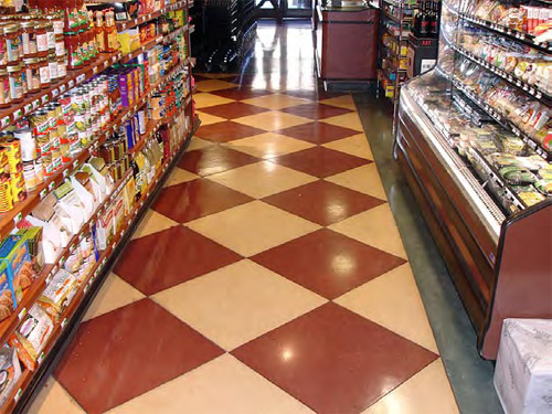 Red and cream checkerboard pattern on concrete in this retail store.