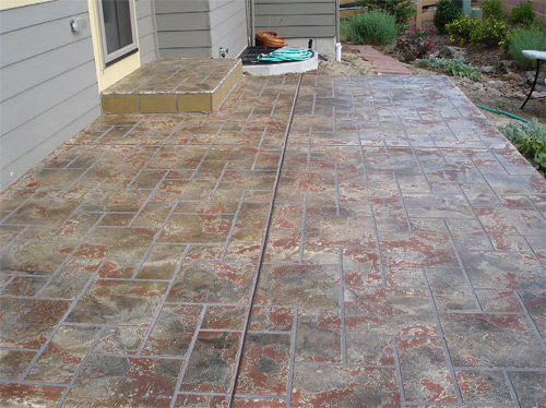 Craig Cowan of Variegate Concrete Concepts, in Lakewood, Colo., applied a solvenated acrylic sealer to protect this overlay, which was textured and colored to look like antique brick. He'll make sure the color stays fresh by revisiting and inspecting the project after one year under warranty.