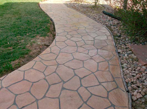 """The """"educate, inform and solve"""" concept is even more essential to the company's approach to fostering relationships in the industry. Although both Heiser and Rose are comfortable up to their elbows in mud, they spend a lot of time in front of local architects, answering questions and championing the decorative concrete cause."""