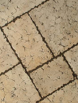 This grouted stamp technique delivers a finished surface that is nearly indistinguishable from actual travertine tiles.