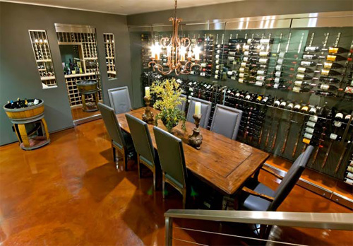 The wine tasting room is upgraded with an acid stain concrete floor.
