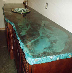 Blue green concrete countertop with textured edge.