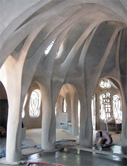 The owners of this home wanted vaulted roofs, very high ceilings and an open floor plan. Steve Kornher accomplished this with a central column (not shown) that keeps the maximum roof span under 5 meters (about 16 feet). Vertical skylights create an airy feeling amid the buttress-like structural arches.