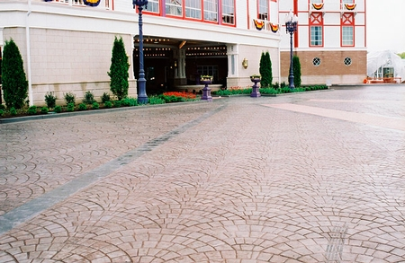 Half-circle stamp pattern in a courtyard of a hotel.