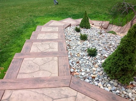Stamped concrete steps make it easier to traverse down this steep backyard hill.