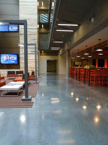 Lobby space that is equipped with high-end concrete floors.