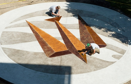 3 dimensional shape stained on a concrete patio