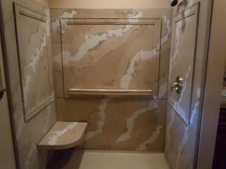 Shower created with a marblized pattern in concrete.