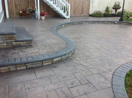 Stamped concrete patio with a curved step.