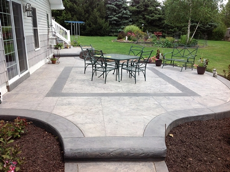 Stamped concrete patio with borders in darker stain.