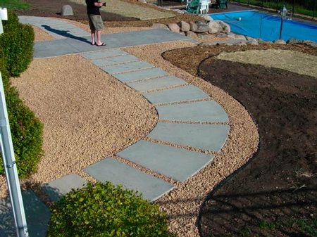 rounded concrete walkway made of individual small concrete pads.