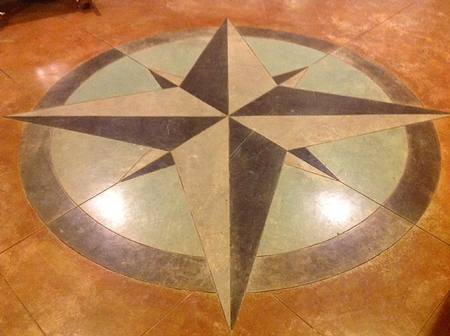 Stained concrete compass rose in multiple colors.