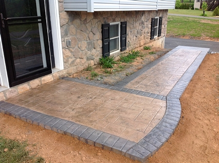 Concrete patio with a stamped and stained border.
