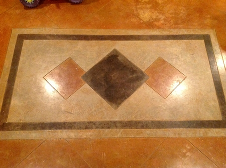 A decorative element stained onto the concrete floor.