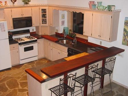 L-shaped concrete countertops make this kitchen pop