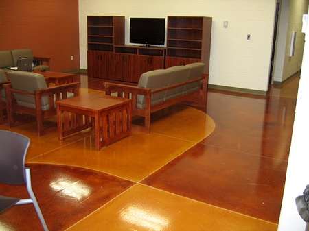 Polished and dyed concrete floor in a living room.