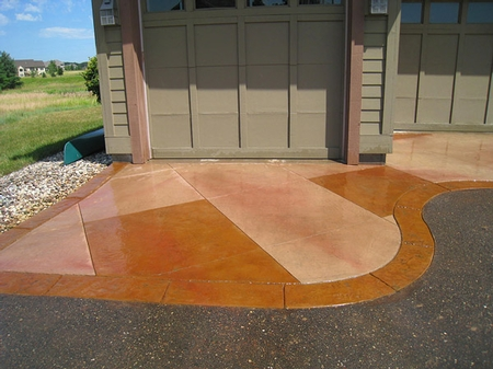 Decorative concrete enhances the garage at the luxury home.