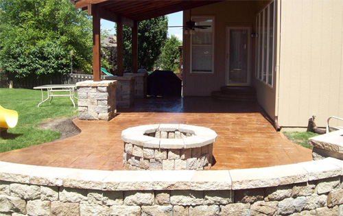 A combination of integral color in buff and a darker release over the top was used to finish this stamped patio and fire pit, done by AAA Construction LLC, of Overland Park, Kan.