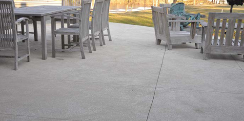 Use concrete to get the luxurious look of travertine tile.