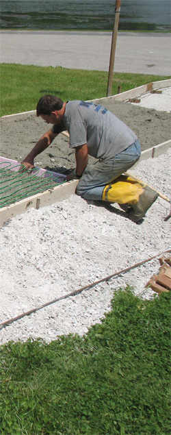 Hydronic heating systems are best suited for large areas. To install them, workers embed specialized tubing in a concrete slab or in a thin concrete mixture over an existing subfloor.