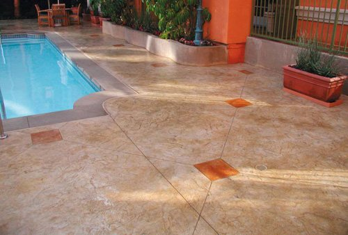 Concrete pool deck that has been brought back to its amazing original self by using tinted color release agent.