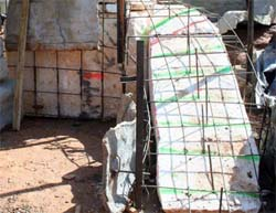 THE FORMING STAGES: Forming the foundation for a free-standing waterfall from concrete blocks or compacted dirt is very time-consuming and expensive. A good alternative is building on extruded polystyrene foam blocks. The foam blocks can be cut into a rough shape and covered with a rebar armature. GFRC castings are then wired to the rebar and backfilled with concrete.