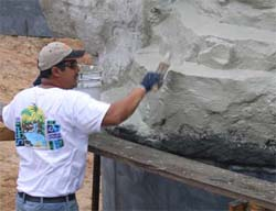 WATERPROOFING: Waterproofing with a hydraulic-cement type of material is critical to prevent leaks and calcium deposits. It is typically not a finish but an underlayment for a finish texture coat.