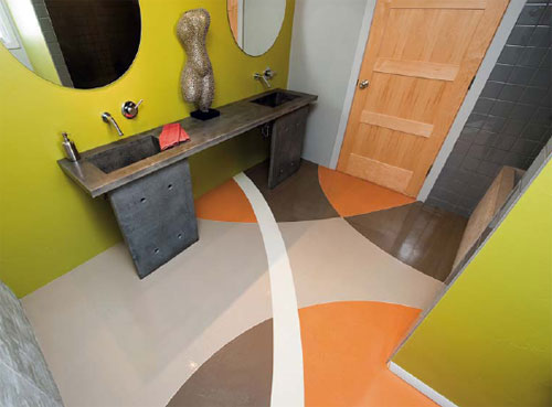 A bathroom is dramatically made over with a brightly stained concrete floor.