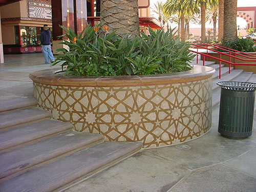 Round cast in place planter for a large palm tree.