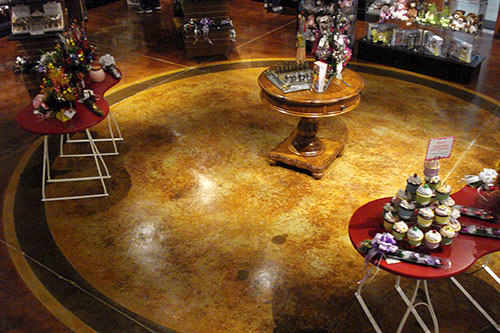 Cupcake shop with stained concrete floors circular center.