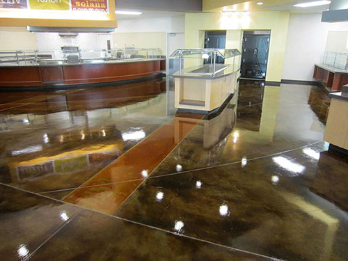 Stained concrete floor with a high gloss finish in a suburban cafeteria.