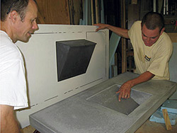 Inspecting the surface of a concrete vanity.