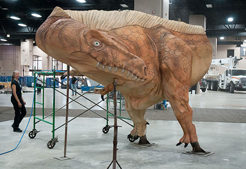 Acrocanthosaurus, a biped, roamed the state of Texas 200 million years ago. The species has returned as a concrete statue crafted at the show.