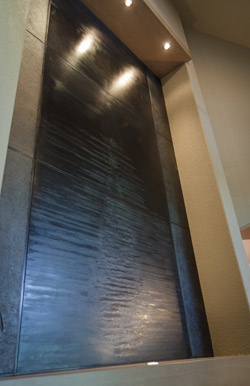 Water fall feather effect fireplace wall.