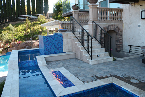 An elaborate water feature and fire feature make this back yard glamorous.