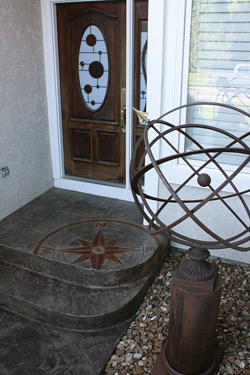 A personal touch of the top step of this entryway of a compass rose, showing the way home.