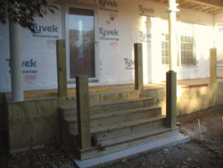 The project began with a deck contractor removing the existing concrete steps, landing and bluestone sidewalk.